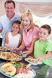 family-dishing-up-dinner