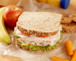 Homemade lunch with sandwich and fruit