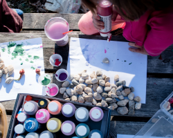 Kids painting rocks outside
