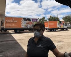 Sally Grant with Feeding America Trucks
