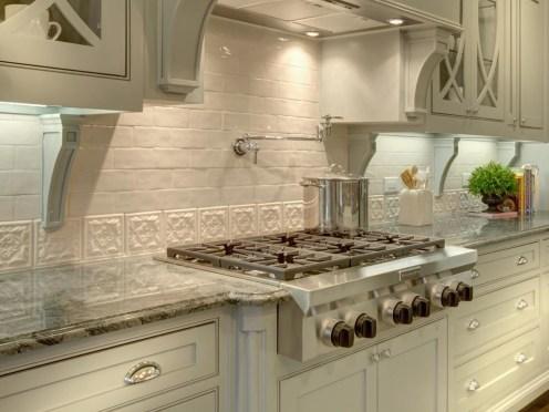 Kitchen-with-white-brick-and-decorative-tile-backsplash