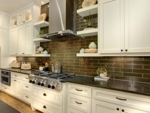 White kitchen cabinets with dark subway tile backsplash