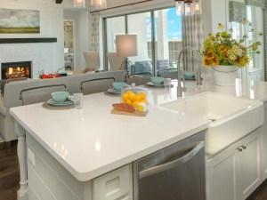 White kitchen island with farmhouse sink