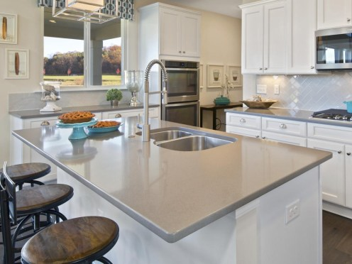 White-kitchen-island-with-gray-solid-surface-countertop