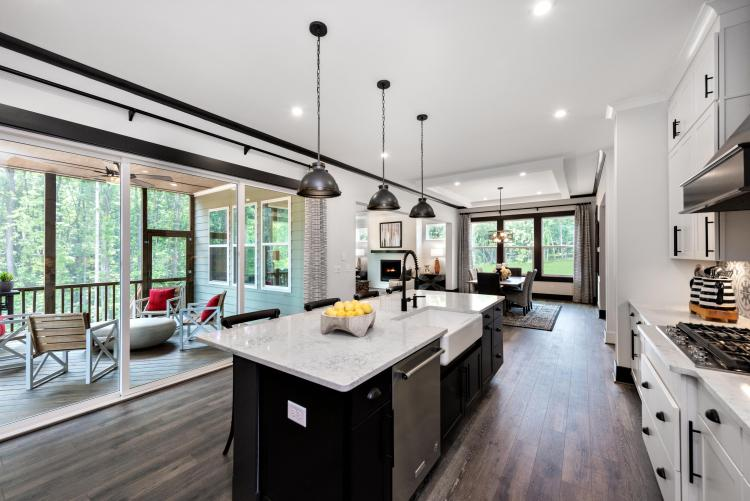 Emerging Home Design Philosophies That Will Dominate in 2021 | The Kaitlin Kitchen with Connecting Outdoor Living Area | Drees Homes