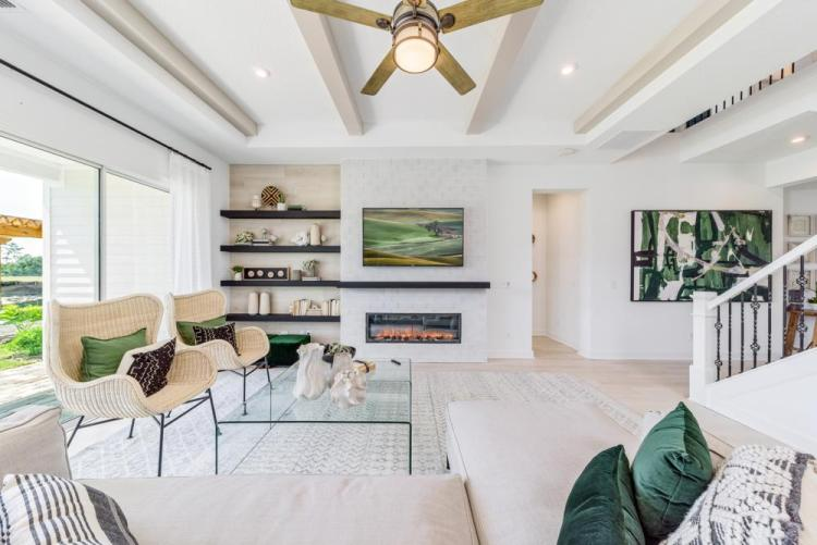 Emerging Home Design Philosophies That Will Dominate in 2021 | The Rowland Family Room with Fireplace | Drees Homes