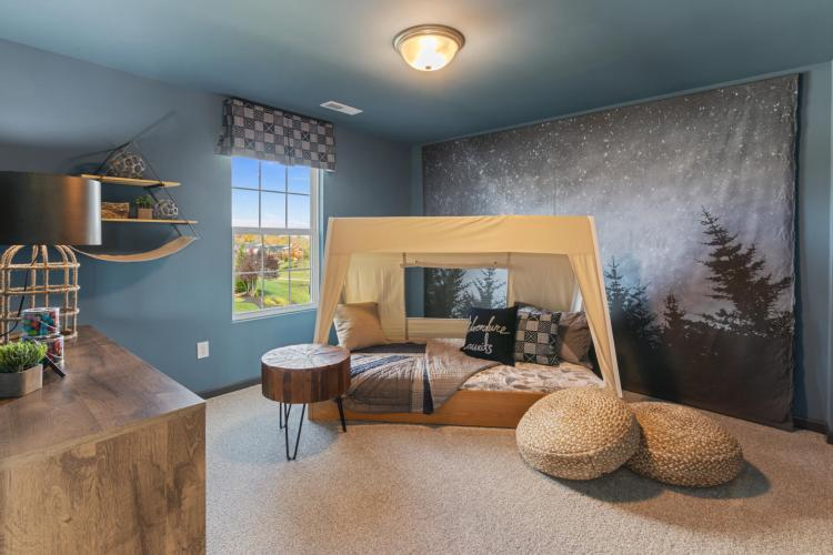 Child's bedroom featuring a camping theme by Drees Homes in Cincinnati
