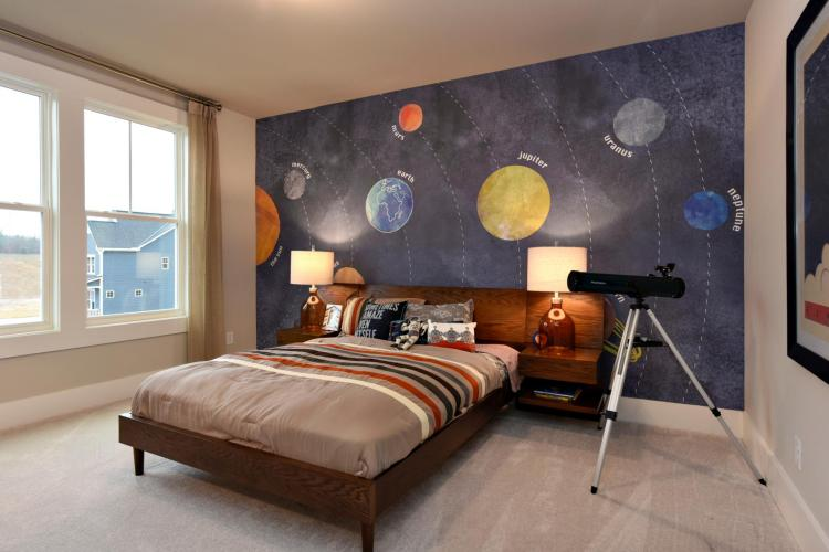 Child's bedroom featuring a space theme by Drees Homes in Raleigh
