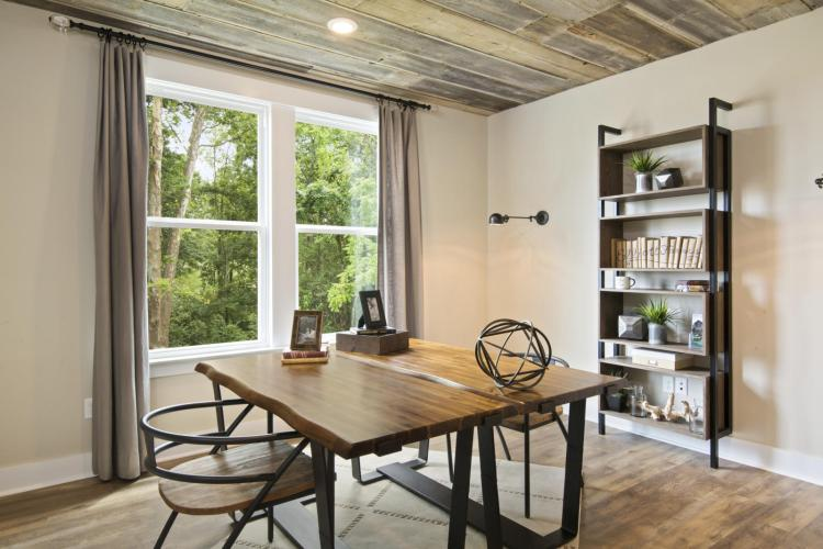 A rustic-inspired study featuring two desks and Buttercream walls