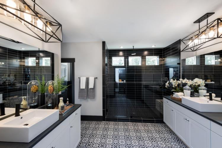 Luxurious owner's suite bathroom featuring an enormous walk-in, super shower and two vanities by Drees Homes in Raleigh