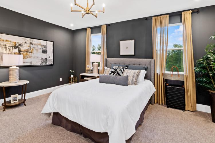 A guest bedroom featuring rich gray walls in the Inkwell shade