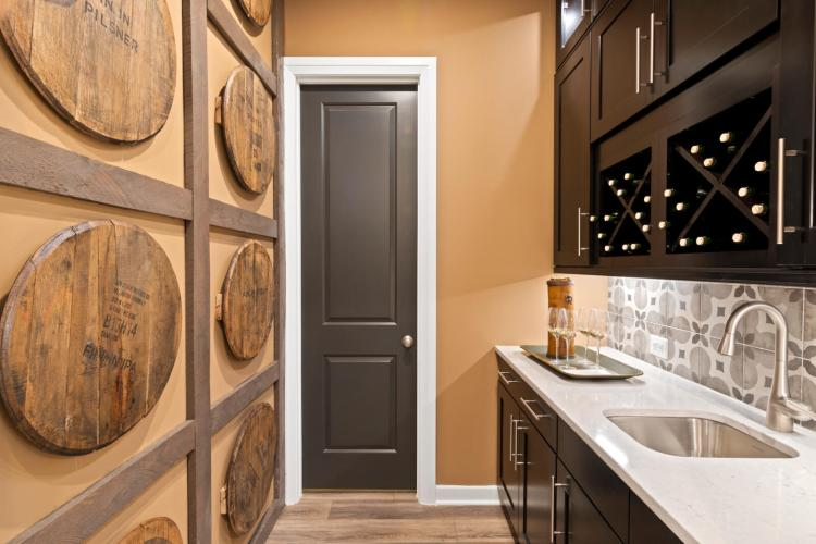 Rustic-inspired working pantry featuring Desert Mist walls, a sink and cabinetry