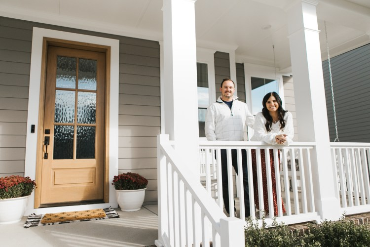 Drees Homeowner Spotlight: Hannah French, Founder and Creative Director at The Highpoint House, and her husband Will on the porch of their new home
