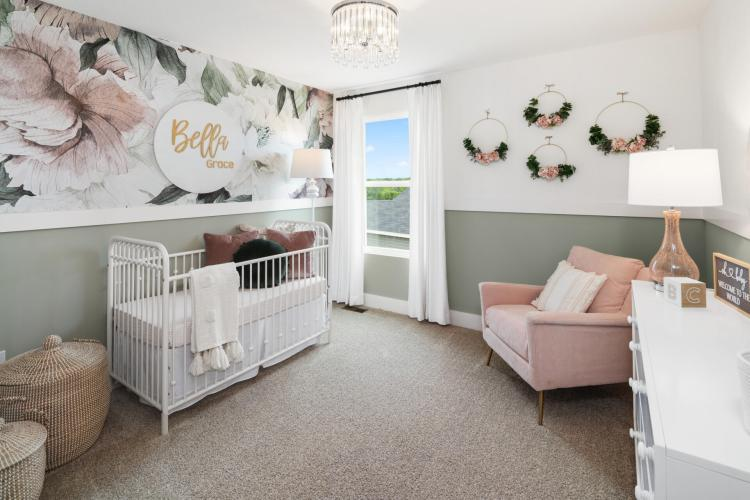 Baby girl nursery featuring a floral theme by Drees Homes in Northern Kentucky