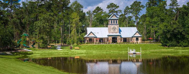 Woodtrace community center in front of Decker Lake in Pinehurst, Texas