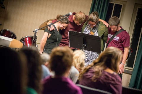College students pray at an InterVarsity Christian Fellowship meeting.  (click for credit)