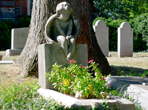 A child's grave at Oak Hill Cemetery, which is in Washington, D.C.  (click for credit)