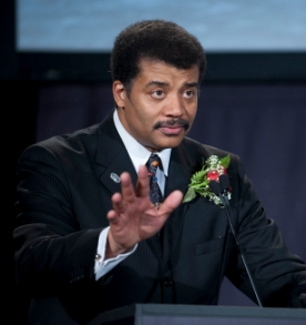 Neil deGrasse Tyson speaking as host at the Apollo 40th anniversary celebration held at the National Air and Space Museum. (click for credit)