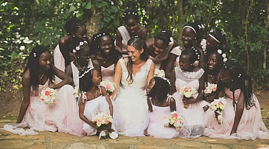 Katie Davis and her 13 adopted daughters on her wedding day.