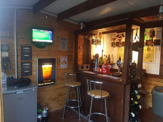 Log Cabin Bar with TV