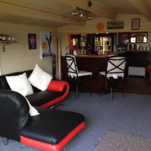 Man Cave from Dunster House furnished as a bar