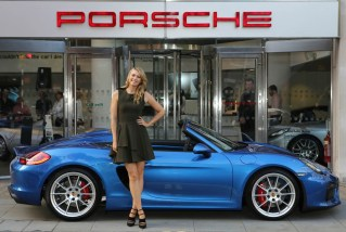 LONDON, ENGLAND - JUNE 25: Maria Sharapova drops in at Porsche Mayfair to go for a spin in the UK's only brand new Porsche Boxster Spyder, on her way to the WTA Pre-Wimbledon Party at Kensington Roof Gardens. June 25, 2015 in London, England. (Photo by David M. Benett/Getty Images) *** Local caption*** Maria Sharapova