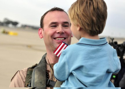 U.S. Navy Lt. Cmdr. Jeff McGrady, a pilot assigned to Helicopter Sea Combat Squadron (HSC) 12, greets his son in San Diego, Calif., after a six-month deployment aboard the aircraft carrier USS Abraham Lincoln (CVN 72) March 19, 2011. HSC-12, part of the Abraham Lincoln Carrier Strike Group, was deployed to the U.S. 5th and 7th Fleet areas of responsibility. (U.S. Navy photo by Seaman Benjamin Crossley/Released)