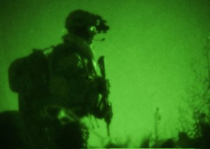 A U.S. Navy SEAL team member with Special Operations Task Force-South provides security during a clearing operation in the Panjwai district of Kandahar province, Afghanistan, April 19, 2011. (U.S. Army photo by Sgt. Daniel P. Shook/Released)