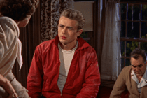 Jim Stark (James Dean) argues with his parents in Rebel Without a Cause.