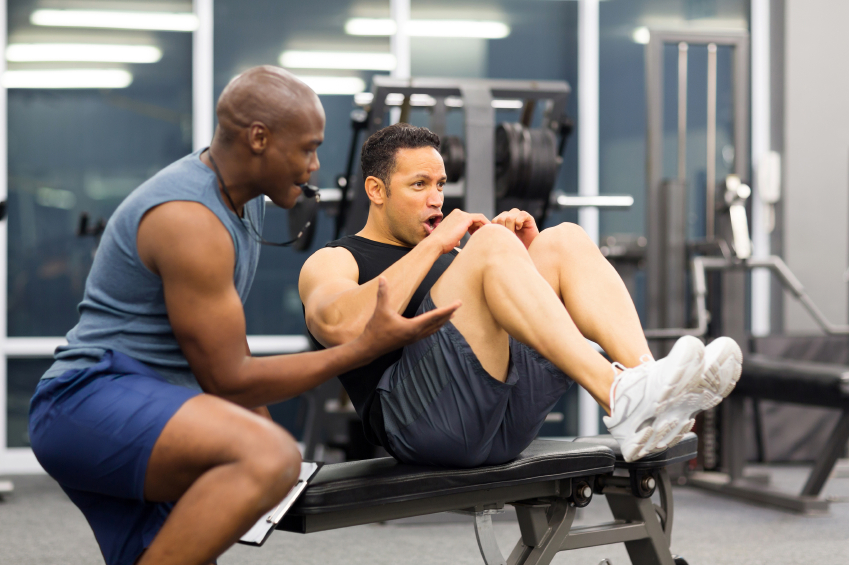 middle aged man with personal trainer - 4 Tips to Finding the Right Personal Trainer for You