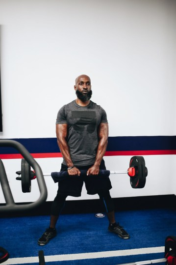 Quincy France in eboost shirt holding a barbell