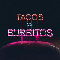 neon sign tacos vs burritos