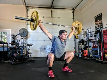 man doing overhead squat