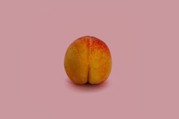 peach butt with pink background