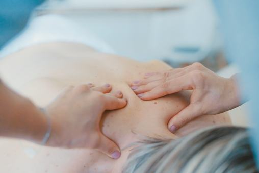 women getting her back rubbed in a massage