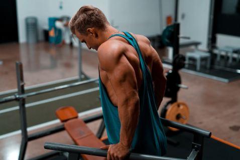 male performing triceps dips