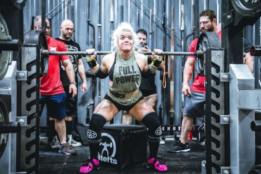 female heavy squat with tough face