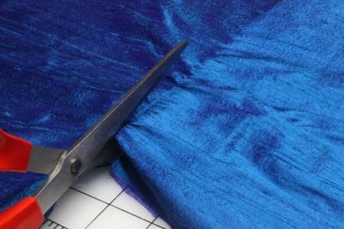 Cutting the Silk Dupioni on the drawn thread line