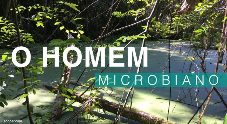Foto mostra pequeno lado rodeado de plantas com a frase O homem microbiano