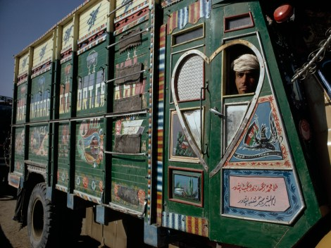 Industrial trucks emblazoned with verse are part of the geography of Afghanistan. Photograph by Thomas J. Abercrombie, National Geographic