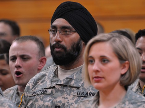 "Capt. (Dr.) Tejdeep Singh Rattan, a dentist and one of three practicing Sikhs in the U.S. military, joins his graduating class in singing ""The Army Goes Rolling Along"" during the Basic Officer Leadership Course graduation ceremony in 2010 at Fort Sam Houston, Texas. Photograph by Steve Elliott, courtesy U.S. Army"