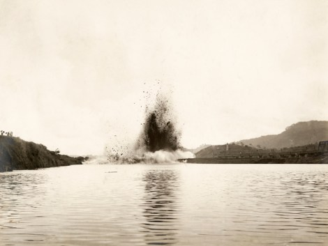 The blast of Gamboa Dike clears the canal's path to the Pacific Ocean. Photograph by Roscoe G. Searle, National Geographic