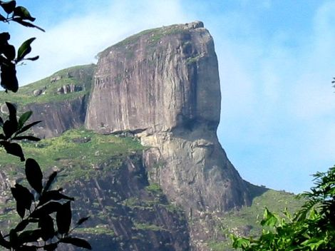 This grumpy-looking rock face is Petra da Gavea, a mountain near Rio de Janeiro, Brazil. Photograph by Parigot, courtesy Wikimedia. I, the copyright holder of this work, release this work into the public domain. This applies worldwide.