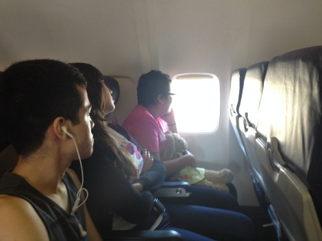 Eric's students on the plane ride to New York City. Photograph by Eric Carlson