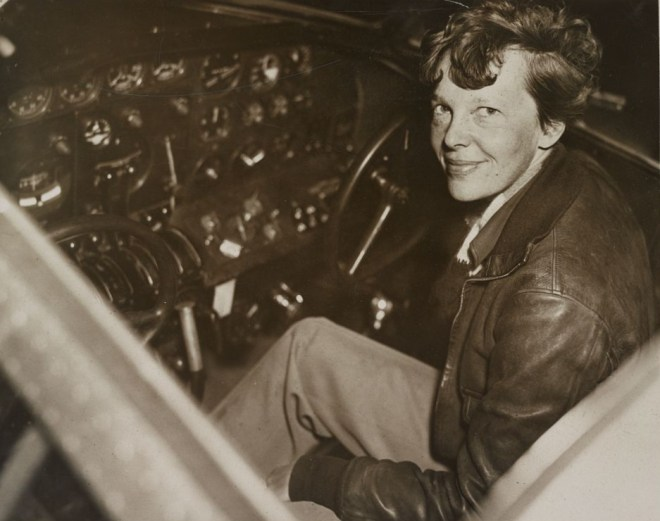 Amelia Earhart smiles at the controls of her modified Lockheed Electra aircraft—the very plane history buffs are searching for. Photograph by Acme Newspictures, courtesy Library of Congress