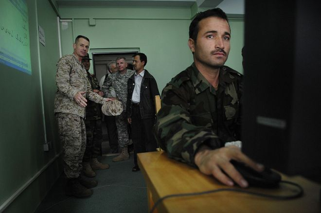 Strengthening the Afghan National Army (ANA) was another goal of the U.S. military in Afghanistan. Here, U.S. Marine Gen. Peter Pace is introduced to a computer training class during his visit to the Afghan military training facility in Kabul. Read more about how U.S. leaders sought to broaden the strength and capacity of the Afghan National Army in this article. Photograph by U.S. Air Force Staff Sgt. D. Myles Cullen, courtesy Wikimedia.