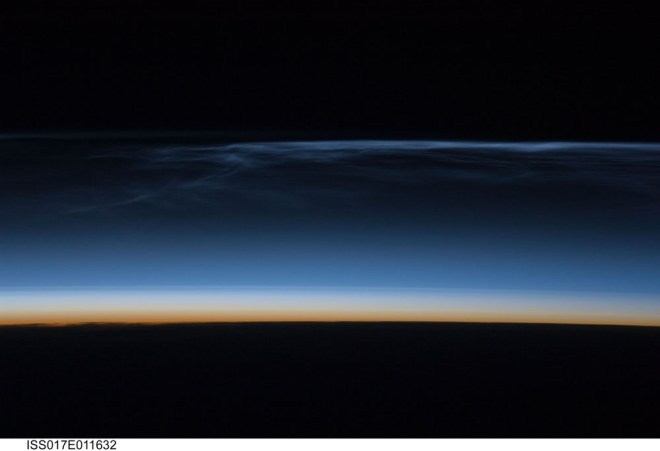 This gorgeous view of noctilucent clouds over Mongolia was taken by the Expedition 17 crew of the International Space Station. The image also shows the reddish hues of the lower atmosphere, as well as stark horizon of Earth itself. Image courtesy NASA