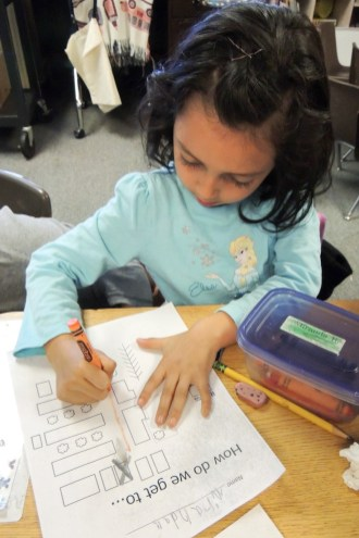 Lisa's student maps her school and builds her spatial skills. Photo by Megan McClain