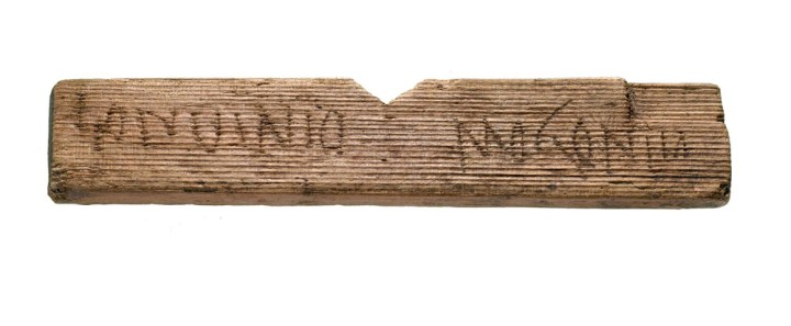 "This fragment of a wooden tablet reads ""Londinio Mogontio,"" which translates to ""In London, to Mogontius."" (Mogontius is a Celtic name.) Photograph courtesy MOLA"