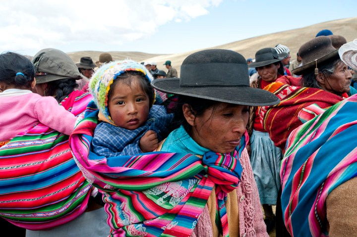 Quechua villagers line up to head out into the hillsides to help with the Gran Chaccu, a yearly round up of vicuña, outside of Picotani, Puno Department, Peru